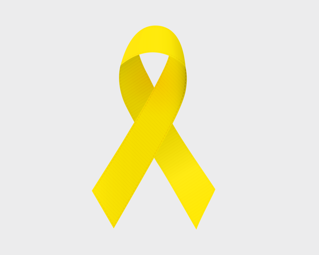 Yellow Ribbon on the back of a light gray background. The yellow ribbon symbolizes Childhood Cancer